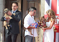 Simon Cowell, David Walliams, Amanda Holden and their dogs attending a photocall for 'Britain's Got Talent' at St Luke's Church, London. 09/04/2014 Picture by: Alexandra Glen / Featureflash