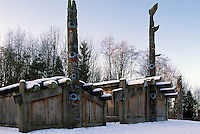 Haida Totem Poles and Plank Houses at Museum of Anthropology, University of BC (UBC), Vancouver, BC, British Columbia, Canada - Southwestern BC Region, Winter.  Traditional six-beam Haida Plank House (left) and Haida Mortuary House (right).