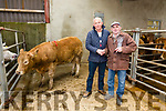 Mike Kissane manager of Cahersiveen Mart on the left presenting John Goggin from Clahananoe, Ballinskelligs with his prize for best Yearling Heifer at the Cahersiveen Mart Spring Heifer Show & Sale on Tuesday.