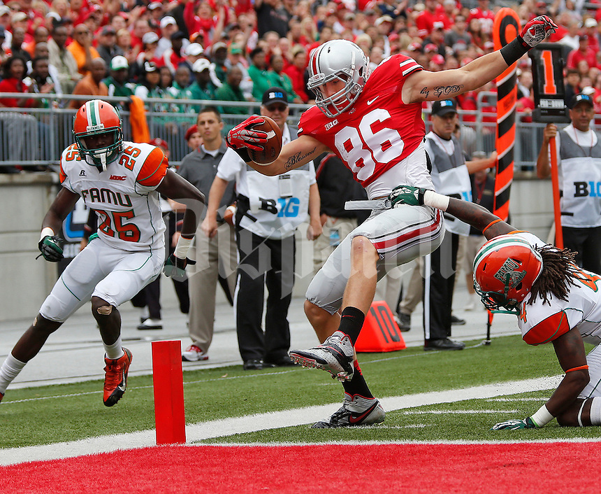 Ohio State Buckeyes tight end Jeff Heuerman (86) steps into the end zone for a first quarter touchdown against Florida A&M at Ohio Stadium on Saturday September 21, 2013.  (Chris Russell/Dispatch Photo)