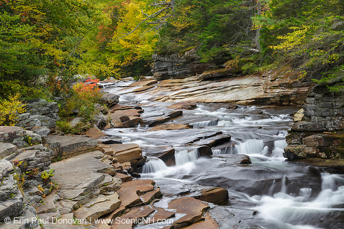 Lower Ammonoosuc Falls on the Ammonoosuc River in Carroll, New Hampshire during autumn months. During the Zealand village era, a logging village built by J.E. Henry, a sawmill was located at Lower Falls.