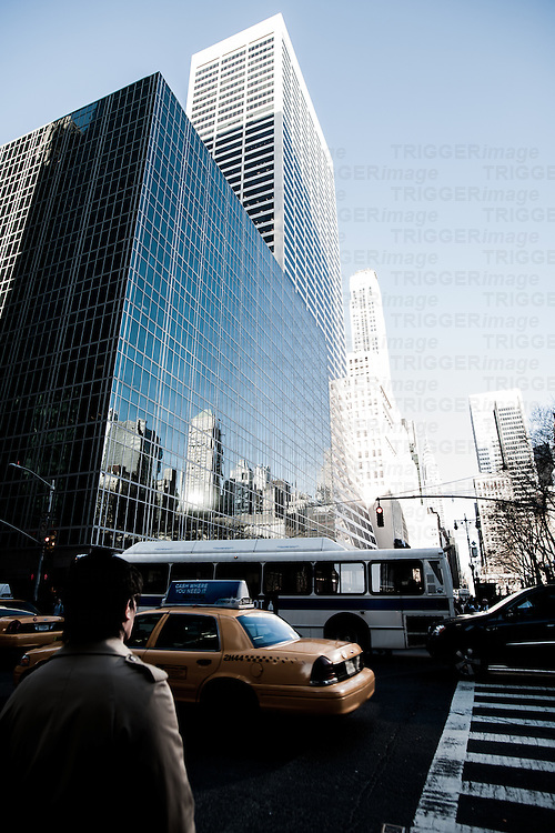 Man walking in street with traffic in New York USA