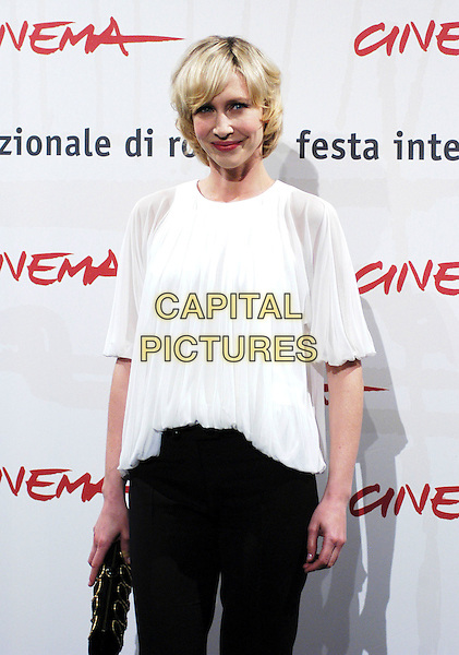 "VERA FARMINGA .Poses at a photocall for her new movie ""The Departed"".on the third day of the Rome Film Festival, Rome, Italy,.October 15th 2006..half length white top black trousers.Ref: CAV.www.capitalpictures.com.sales@capitalpictures.com.©Luca Cavallari/Capital Pictures."
