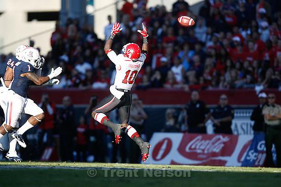 Trent Nelson  |  The Salt Lake Tribune.Utah's DeVonte Christopher leaps and misses a pass during the first half as Utah faces Arizona, college football at Arizona Stadium in Tucson, Arizona, Saturday, November 5, 2011.