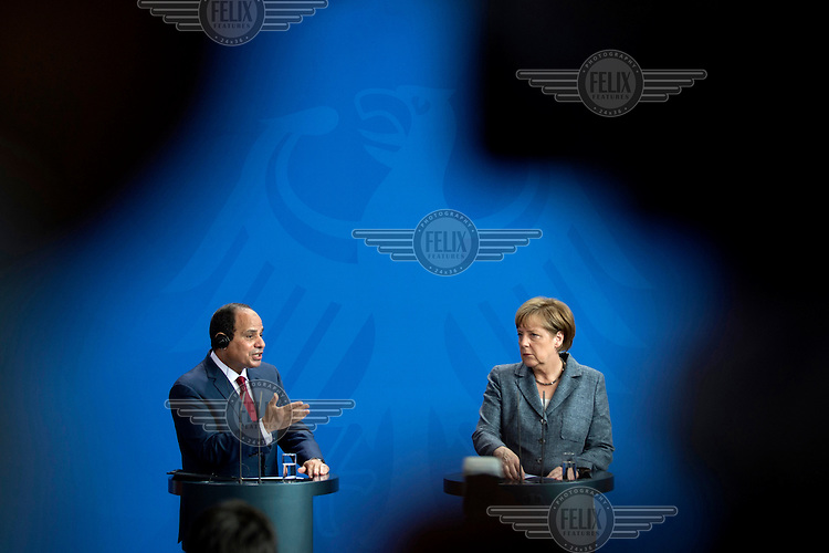 German Chancellor Angela Merkel and Egyptian President Abdel Fattah Saeed Hussein Khalil al-Sisi during a press conference at the Chancellery. The meeting between the two leaders was intended to increase economic and security cooperation but was overshadowed by Egypt's human rights issues.