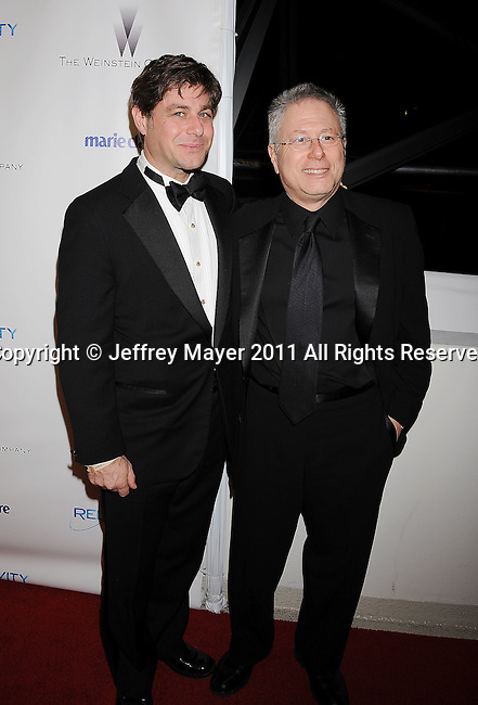 BEVERLY HILLS, CA - January 16: Glenn Slater and Alan Menken arrive at The Weinstein Company and Relativity Media's 2011 Golden Globe After Party presented by Marie Claire held at BAR 210 - The Beverly Hilton Hotel on January 16, 2011 in Beverly Hills, California.
