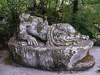 Bomarzo, Viterbo - Parco dei Mostri o Sacro Bosco, complesso monumentale realizzato nel 1547con grandi sculture di figure mitologiche del genere grotesque. Donna dormiente<br /> Bomarzo, Viterbo - Monster Park or Sacro Bosco, a monumental complex built in 1547 with large sculptures of mythological figures such grotesque. Sleeping woman