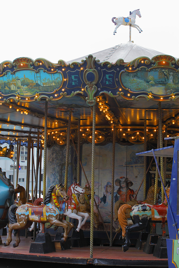 In Paris, near Montparnasse, a typical old carousel with its horses and its beautiful decorations and paintings. Digitally Improved Photo.