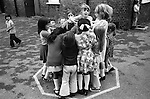 Junior school children girls playing playground games. South London. 1970s England. UK..