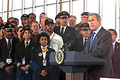 United States President George W. Bush makes remarks prior to signing the Aviation security bill at Ronald Reagan Washington National Airport in Washington, DC on November 19, 2001.  <br /> Credit: Ron Sachs / CNP