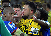 Stormers hooker Bongi Mbonambi and Hurricanes centre Matt proctor tussle after the final whistle of the Super Rugby match between the Hurricanes and Stormers at Westpac Stadium in Wellington, New Zealand on Saturday, 23 March 2019. Photo: Dave Lintott / lintottphoto.co.nz