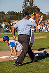 San Marin third baseman Ryan Schalch tags Acalanes baserunner Paul Nork. Nork was picked off third base during the North Coast Section Division 3 final at San Marin High School on June 7, 2011. The  umpires suspended the game after 10 innings with the score 4-4. NCS officials declared both teams Co-champions.