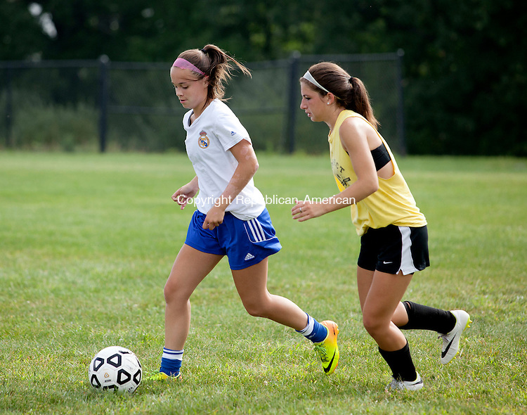 BEACON FALLS, CT-26 August 2014-082614BF01- Woodland Regional High School girls soccer players and co-captains Rosalina Santos, left, and Marisa Macek prepare for the season during practice Tuesday morning at the school in Beacon Falls.  Bob Falcetti Republican-American