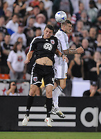 Los Angels Galaxy midfielder David Beckham (23) goes up to head the ball against DC United defender Marc Burch (4)  DC United tied with Los Angeles Galaxy 0-0 at RFK Stadium, Saturday August 22, 2009.