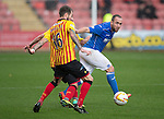 Partick Thistle v St Johnstone....25.10.14   SPFL<br /> Lee Croft is closed down by Jordan McMillan<br /> Picture by Graeme Hart.<br /> Copyright Perthshire Picture Agency<br /> Tel: 01738 623350  Mobile: 07990 594431