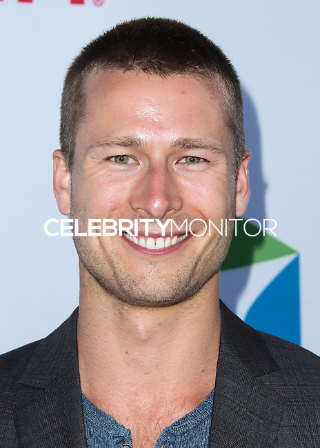 SANTA MONICA, CA, USA - JUNE 11: Glen Powell at the Pathway To The Cures For Breast Cancer: A Fundraiser Benefiting Susan G. Komen held at the Barker Hangar on June 11, 2014 in Santa Monica, California, United States. (Photo by Xavier Collin/Celebrity Monitor)