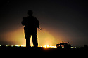 Iraq 2009.Oilfield of Kirkuk with a watchman by night   Irak 2009. Champ de petrole de Kirkouk, la nuit, sous surveillance