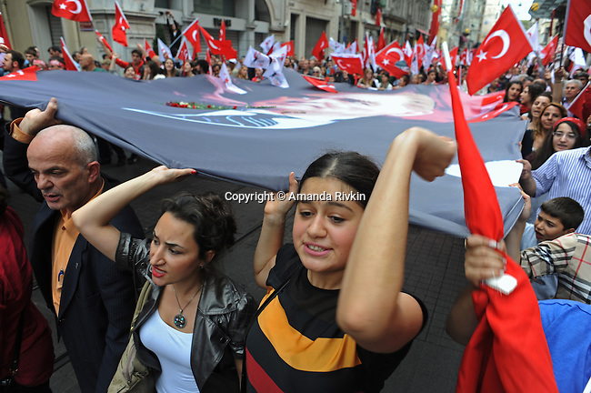 Nationalist demonstrators carry an oversized banner portrait of Mustafa Kemal Ataturk, the founder of the Turkish Republic, as they march up Istiklal Caddesi from Tunel in support of Ataturk's principles of a secular republic and against the ruling Justice and Development Party, AKP in Turkish, on Republic Day in Istanbul, Turkey on October 29, 2012.