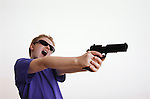 boy aims handgun