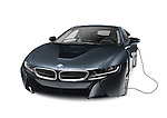 Black 2016 BMW i8 plug-in hybrid electric luxury sports car with charging cord isolated on white background with clipping path Image © MaximImages, License at https://www.maximimages.com