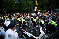 NEW YORK, NEW YORK - June 25: NYPD officers block the entrance of Brooklyn Bridge as people march as others take part in a protest encampment near NYC City hall on June 25, 2020 in New York, NY. Demonstrators are calling for $1 billion in cuts of NYPD, as they protest encampment near City Hall and NYPD headquarters ahead of the city July 1 budget deadline.  (Photo by Eduardo MunozAlvarez/VIEWpress)