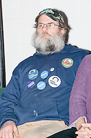 Sanders supporter Gordon Webber, of Antrim, NH, sits behind the candidate as Vermont senator and Democratic presidential candidate Bernie Sanders speaks to senior citizens at the Peterborough Community Center gymnasium in Peterborough, New Hampshire.