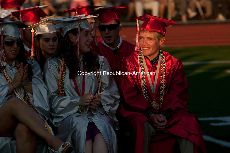 WOLCOTT, CT 18 JUNE, 2010-061810JS01-Wolcott Valedictorian Christopher Bendtsen, right, smiles as he is recognized during graduation ceremonies at Wolcott High School in Friday. <br /> Jim Shannon Republican-American