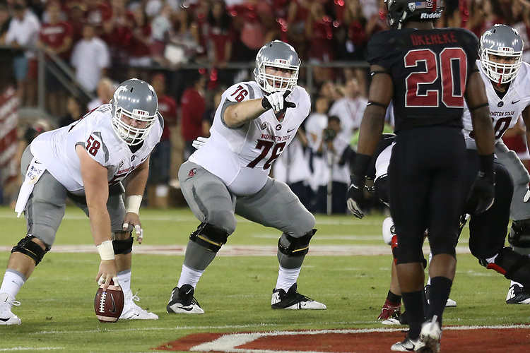 Riley Sorensen (58), Cody O'Connell (76) and Andre Dillard (60), Washington State offensive linemen, make their pre-snap calls during the Cougars Pac-12 Conference road victory over the Stanford Cardinal, 42-16, on October 8, 2016, at Stanford Stadium in Palo Alto, California.