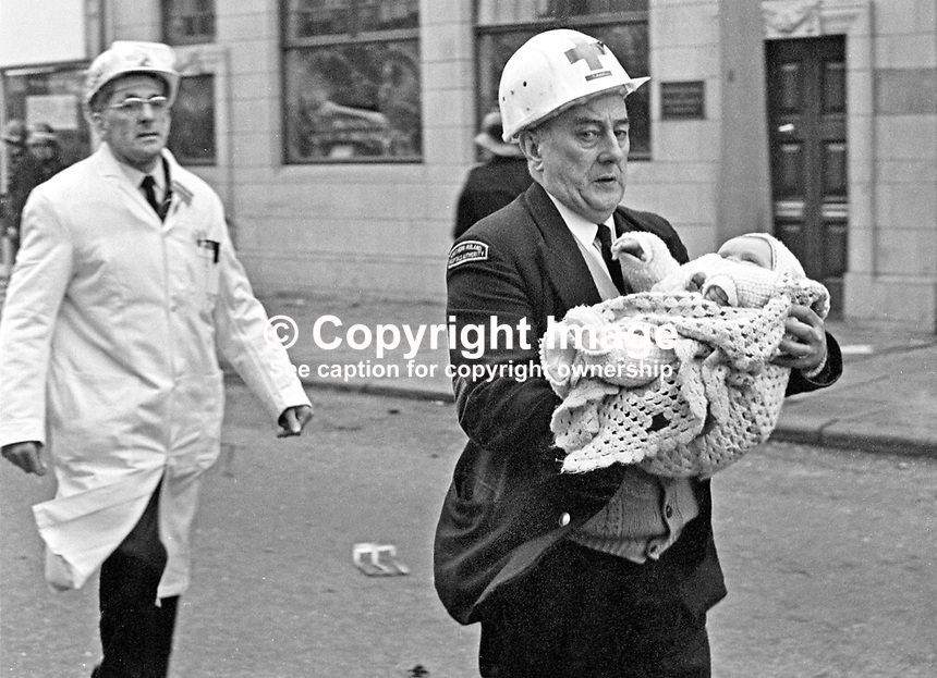 An ambulanceman carries an injured child from the scene of a Provisional IRA car bomb explosion in Bradbury Place, Belfast, N Ireland. 197201210021d.<br /> <br /> Copyright Image from Victor Patterson, 54 Dorchester Park, Belfast, UK, BT9 6RJ<br /> <br /> t1: +44 28 9066 1296 (from Rep of Ireland 048 9066 1296)<br /> t2: +44 28 9002 2446 (from Rep of Ireland 048 9002 2446)<br /> m: +44 7802 353836<br /> <br /> victorpattersonbelfast@gmail.com<br /> victorpatterson@me.com<br /> <br /> www.victorpatterson.com<br /> <br /> Please see my Terms and Conditions of Use at https://www.victorpatterson.com/page2<br /> It is IMPORTANT that you familiarise yourself with them.<br /> <br /> Images used on the Internet incur an additional cost and must be visibly watermarked i.e. &copy; Victor Patterson within the body of the image and copyright metadata must not be deleted. Images used on the Internet have a size restriction of 4kbs and are chargeable at rates available at victorpatterson.com.<br /> <br /> This image is available only for the use of the download recipient i.e. television station, newspaper, magazine, book publisher, etc, and must not be passed on to any third party. It is also downloaded on condition that each and every usage is notified within 7 days to victorpatterson@me.com<br /> <br /> The right of Victor Patterson (or the named photographer) to be identified as the author is asserted in accordance with The Copyright Designs And Patents Act (1988). All moral rights are asserted.