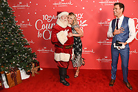 "20 November 2019 - Hollywood, California - Debbie Matenopoulos, Cameron Mathison. Hallmark Channel's 10th Anniversary Countdown to Christmas - ""Christmas Under the Stars"" Screening and Party. Photo Credit: Billy Bennight/AdMedia"