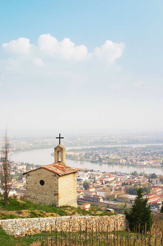 The Hermitage chapel on top of the hill with a view across the river on Tournon. The Hermitage vineyards on the hill behind the city Tain-l'Hermitage, on the steep sloping hill, stone terraced. Sometimes spelled Ermitage. The twin towns Tain Tournon by the river Tain l'Hermitage, Drome, Drôme, France, Europe