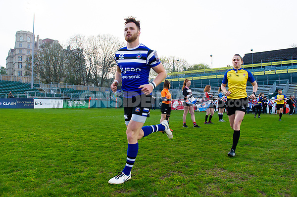 Max Wright and the rest of the Bath United team run onto the field. Premiership Rugby Shield match, between Bath United and Gloucester United on April 8, 2019 at the Recreation Ground in Bath, England. Photo by: Patrick Khachfe / Onside Images