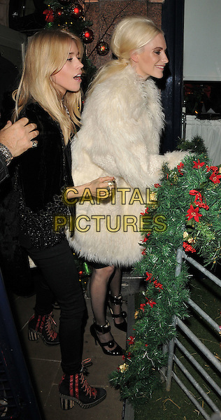 Lady Mary Charteris &amp; Poppy Delevingne attend the LOVE magazine Christmas party, George Club, Mount Street, London, UK, on Friday 18 December 2015.<br /> CAP/CAN<br /> &copy;Can Nguyen/Capital Pictures