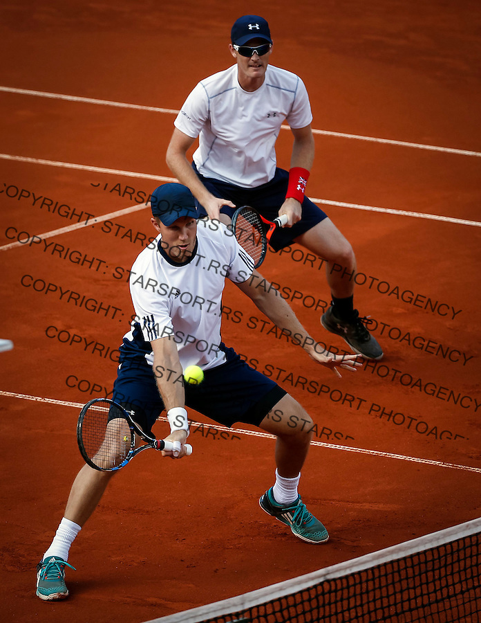 BELGRADE, SERBIA - JULY 16: Jamie Murray (R) and Dominic Inglot (L) of Great Britain compete in the doubles match against Nenad Zimonjic and Filip Krajinovic during day two of the Davis Cup Quarter Final match between Serbia and Great Britain on Stadium Tasmajdan on July 16, 2016 in Belgrade, Serbia. (Photo by Srdjan Stevanovic/Getty Images)