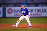 Tulsa Drillers center fielder Alex Verdugo (9) leads off second during a game against the Arkansas Travelers on April 25, 2016 at ONEOK Field in Tulsa, Oklahoma.  Tulsa defeated Arkansas 4-3.  (Mike Janes/Four Seam Images)