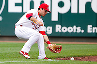 Alan Ahmady (38) of the Springfield Cardinals fields a ball hit to right field during a game against the Arkansas Travelers on May 10, 2011 at Hammons Field in Springfield, Missouri.  Photo By David Welker/Four Seam Images.