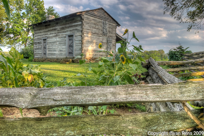 George Roger Clark's log cabin sits on a bluff above the Falls of Ohio around the Ohio River from Louisville, Ky. This Virginia native founded Louisville and explored the Louisiana  Purchase with Meriweather Lewis. They launched the famous exploration from his spot.
