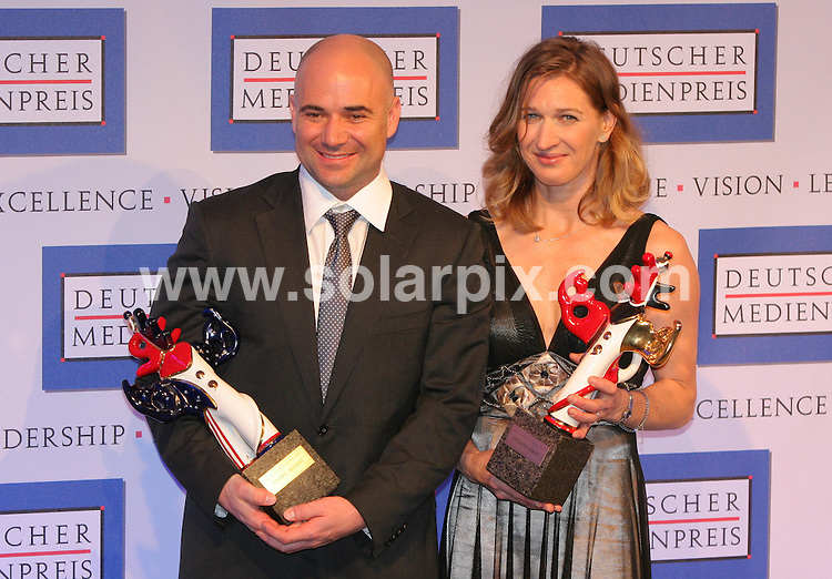 **ALL ROUND PICTURES FROM SOLARPIX.COM**.**SYNDICATION RIGHTS FOR UK AND SPAIN ONLY**.The Former Tennis-player Steffi Graf and her husband Andre Agassi at the red carpet for the award ceremony of the German Media Award 2007 in Baden-Baden in Germany on 24th February 2008. The couple has been awarded for their exemplary engagement for unprivileged children..This pic:ANDRE AGASSI,STEFFI GRAF.JOB REF: 5840-CPR        DATE:24_02_08.**MUST CREDIT SOLARPIX.COM OR DOUBLE FEE WILL BE CHARGED* *UNDER NO CIRCUMSTANCES IS THIS IMAGE TO BE REPRODUCED FOR ANY ONLINE EDITION WITHOUT PRIOR PERMISSION*