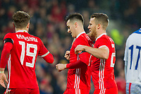Tom Lawrence of Wales (centre) celebrates scoring his side's first goal with Marley Watkins and Tom Bradshaw during the International Friendly match between Wales and Panama at the Cardiff City Stadium, Cardiff, Wales on 14 November 2017. Photo by Mark Hawkins.