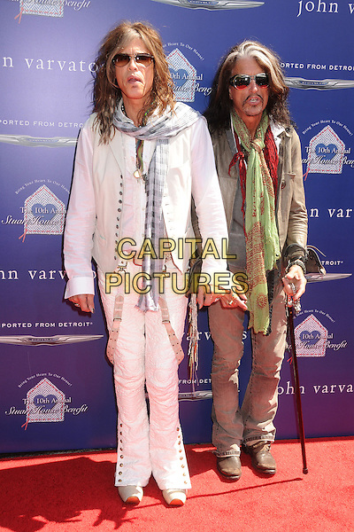 Steven Tyler & Joe Perry of Aerosmith.10th Annual John Varvatos Stuart House Benefit held at John Varvatos Boutique, Beverly Hills, California, USA..March 10th, 2013.full length jacket jeans denim white green blue check scarf grey gray cane sunglasses shades moustache mustache facial hair .CAP/ADM/BP.©Byron Purvis/AdMedia/Capital Pictures.