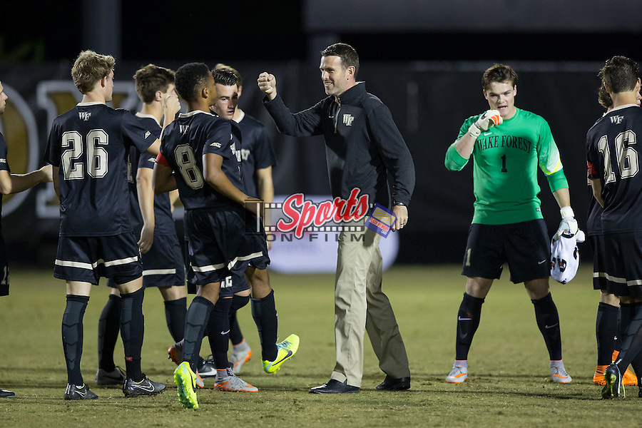 Wake Forest Demon Deacons head coach Bobby Muuss fist bumps with his team prior to the start of the match against the Georgia State Panthers at Spry Soccer Stadium on October 20, 2015 in Winston-Salem, North Carolina.  The Demon Deacons defeated the Panthers 5-0.  (Brian Westerholt/Sports On Film)
