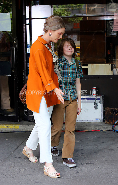 WWW.ACEPIXS.COM<br /> <br /> May 19 2016, New York City<br /> <br /> Actress Julianne Moore and actor Oakes Fegley were on the Upper West Side set of the new movie 'Wonderstruck' on May 19 2016 in New York City<br /> <br /> By Line: Philip Vaughan/ACE Pictures<br /> <br /> ACE Pictures, Inc.<br /> tel: 646 769 0430<br /> Email: info@acepixs.com<br /> www.acepixs.com