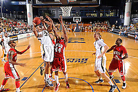 28 January 2012:  FIU guard-forward Dominique Ferguson (3) is fouled by WKU guard-forward George Fant (44) while shooting in the second half as the Western Kentucky University Hilltoppers defeated the FIU Golden Panthers, 61-51, at the U.S. Century Bank Arena in Miami, Florida.