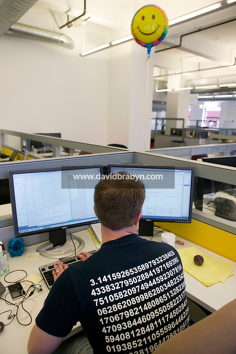 5 October 2006 - New York City, NY - A Google employee works in the company's new office on Eighth Avenue in New York City, USA, 5 October 2006. The 300,000-square foot office cover 3 floors of a block-long building and houses advertising and engineering teams.