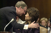 Washington, DC - January 24, 2001 -- Elaine Chao, U.S. Secretary of Labor-designate gets a kiss from her husband, U.S. Senator Mitch McConnell during her confirmation hearing before the U.S. Senate Health, Education, Labor and Pensions Committee.<br /> Credit: Ron Sachs / CNP