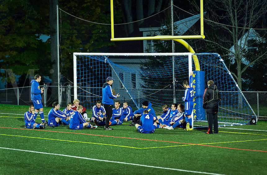 Soccer team gets half time pep talk from coach, Maine, USA