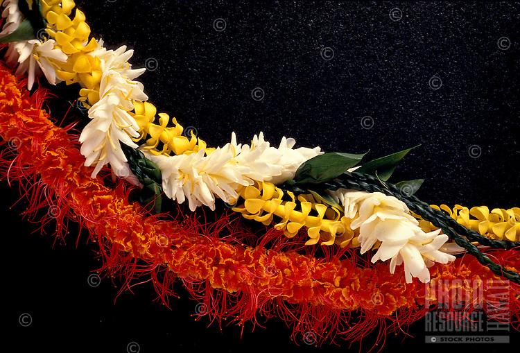 Ohai Alii, Puakenikeni & Ti leaf & white ginger on black backround