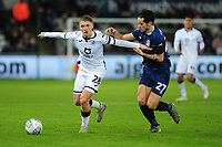 George Byers of Swansea City vies for possession with Lewis Travis of Blackburn Rovers during the Sky Bet Championship match between Swansea City and Blackburn Rovers at the Liberty Stadium in Swansea, Wales, UK. Wednesday 11 December 2019