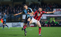 Luke O'Nien of Wycombe Wanderers & Peter Murphy of Morecambe  during the Sky Bet League 2 match between Wycombe Wanderers and Morecambe at Adams Park, High Wycombe, England on 2 January 2016. Photo by Andy Rowland / PRiME Media Images