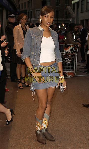 """JAVINE HYLTON.""""Rollin' With The Nines"""" - UK premiere at the Odeon Leicester Square, London, UK..April 19th, 2006.Ref: CAN.full length brown blue cowboy boots jeans jean denim skirt ripped torn jacket.www.capitalpictures.com.sales@capitalpictures.com.©Capital Pictures"""